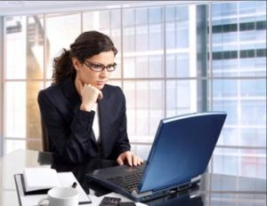 woman on computer with glasses