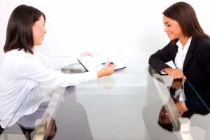 business-women-2-over-table